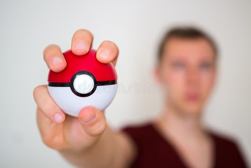 Download Jeune Homme Tenant Le Pokeball Image éditorial - Image du aventure, pokemon: 77157145