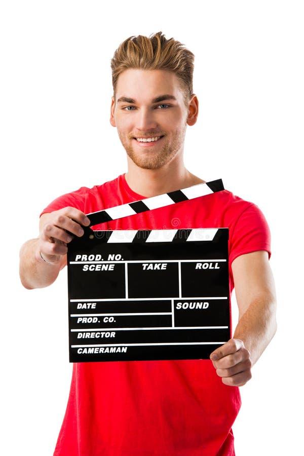 Jeune homme tenant un bardeau photos stock