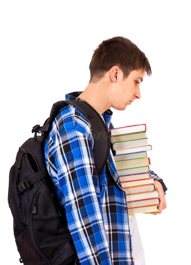 Jeune homme triste avec livres image libre de droits