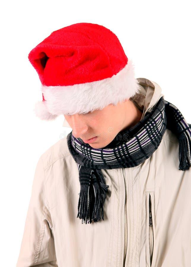 Jeune homme triste en Santa Hat photographie stock