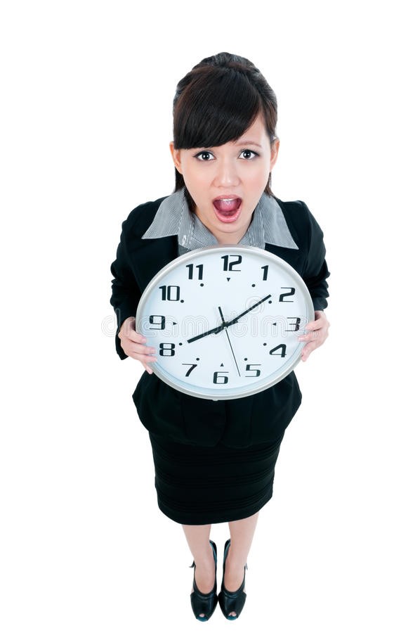 Jeune horloge de fixation de femme d'affaires image libre de droits