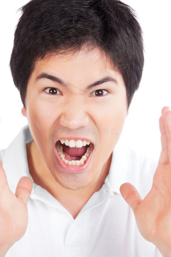 Jeune hurlement asiatique d'homme photos libres de droits