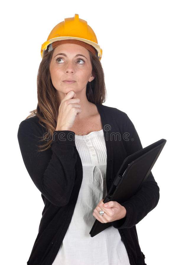 Jeune ingénieur avec le visage et le casque songeurs photo libre de droits