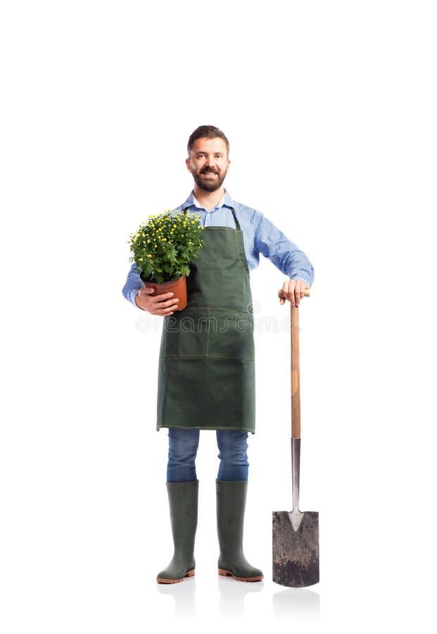 Jeune jardinier beau image stock