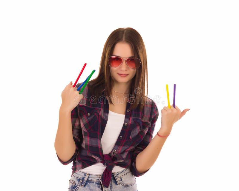 Jeune jolie femme avec des marqueurs, d'isolement photographie stock libre de droits