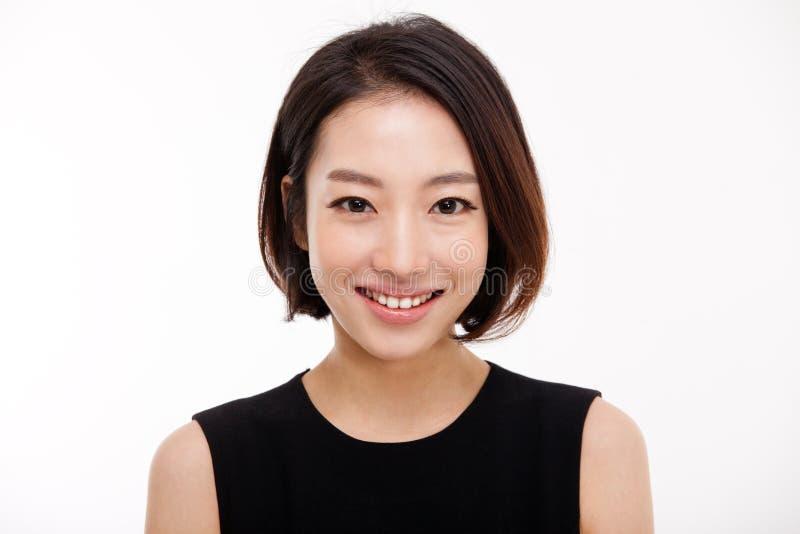 Jeune jolie fin asiatique de femme d'affaires vers le haut de verticale. images stock