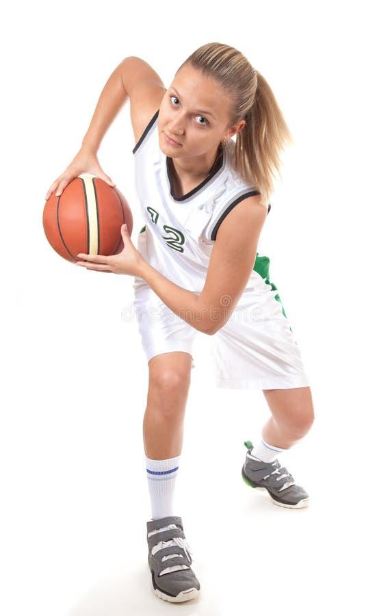 Jeune joueur de basket dans l'action photo libre de droits