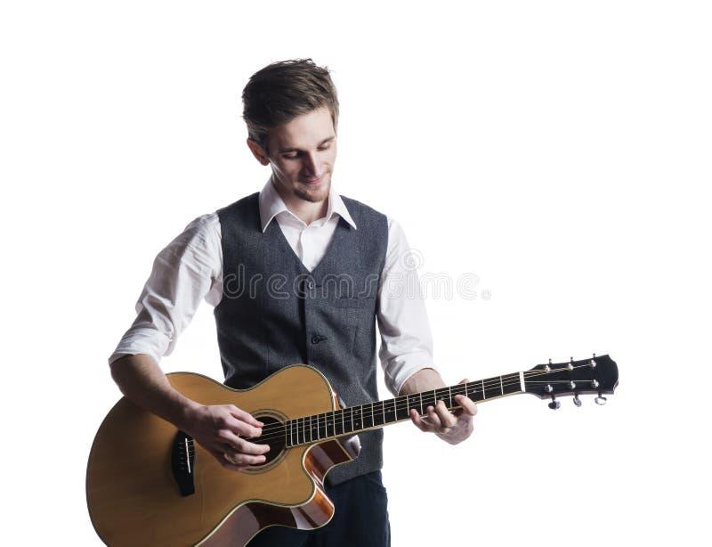 Jeune joueur de guitare photos stock