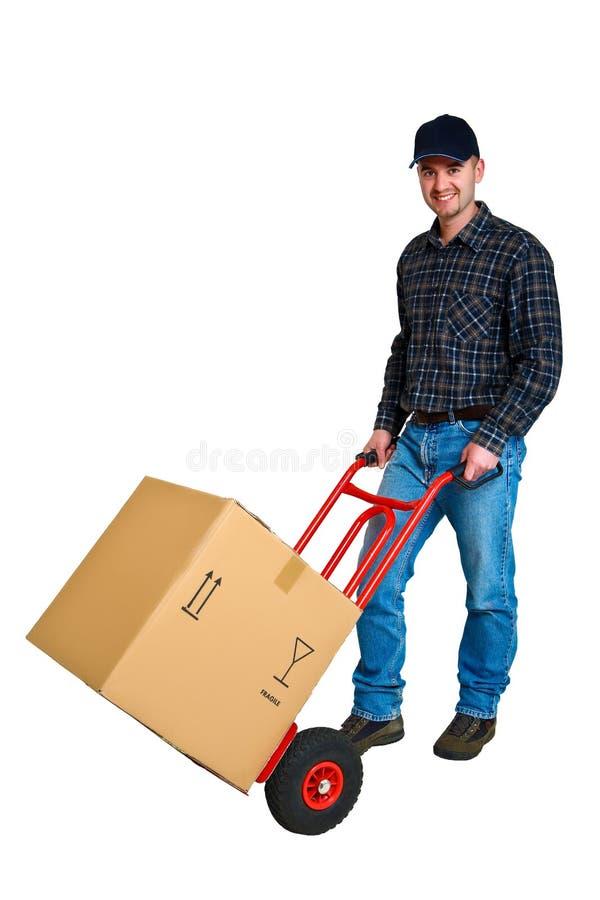 Jeune livreur d'isolement avec son camion de main photographie stock