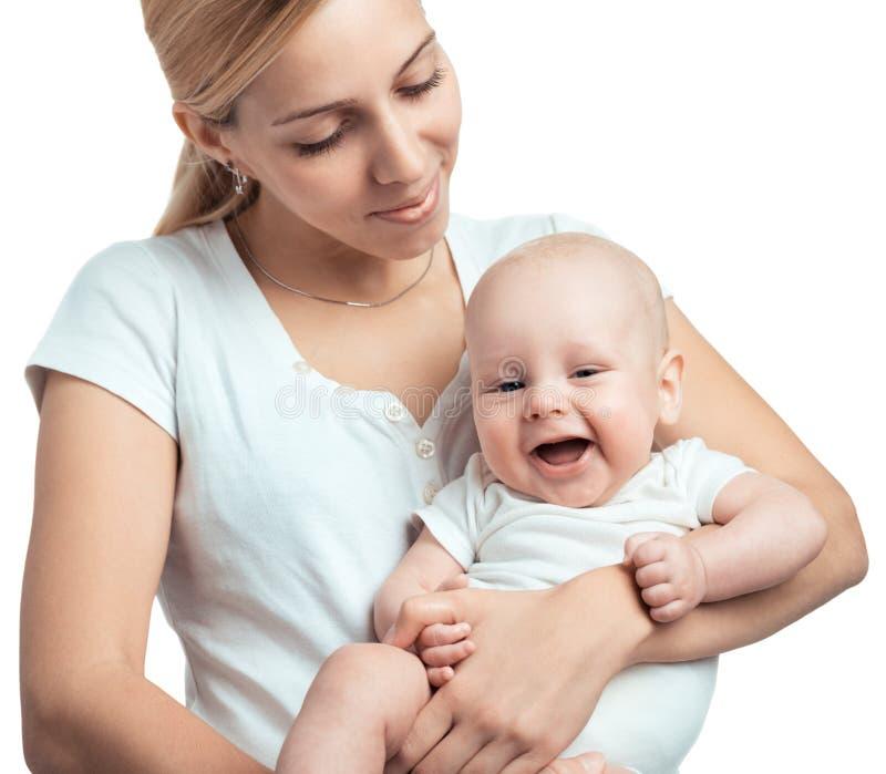 Jeune mère étreignant le bébé photos stock