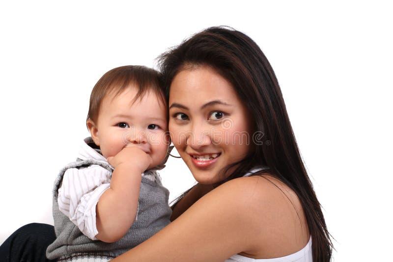 Jeune mère avec la chéri photographie stock