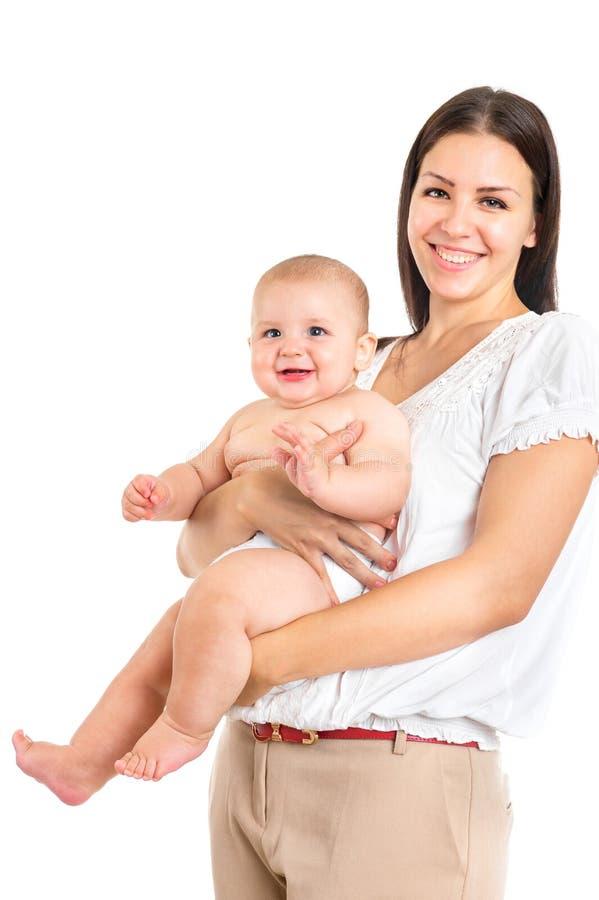 Jeune mère heureuse avec le nourrisson d'isolement sur le blanc image libre de droits