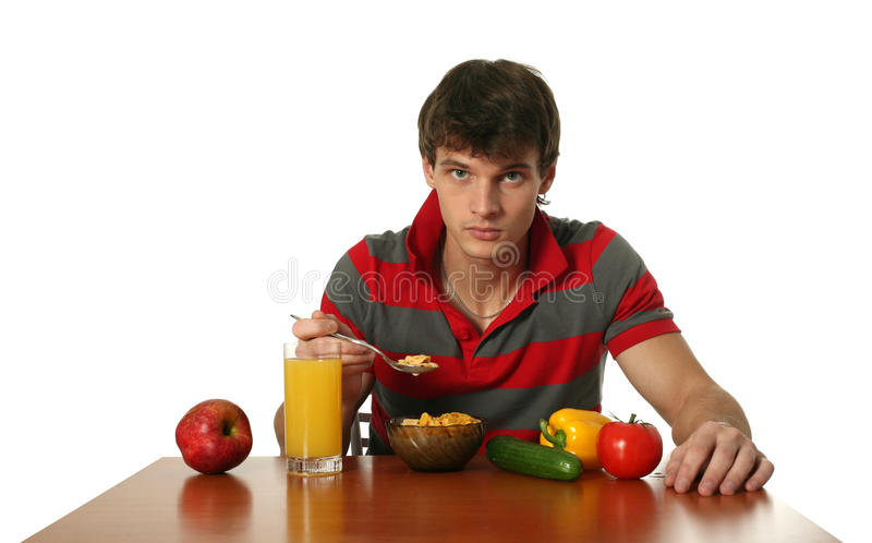 Jeune mangeur d'hommes sexy son déjeuner image stock