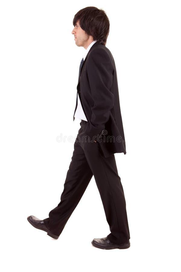 Jeune marche d'homme d'affaires photographie stock