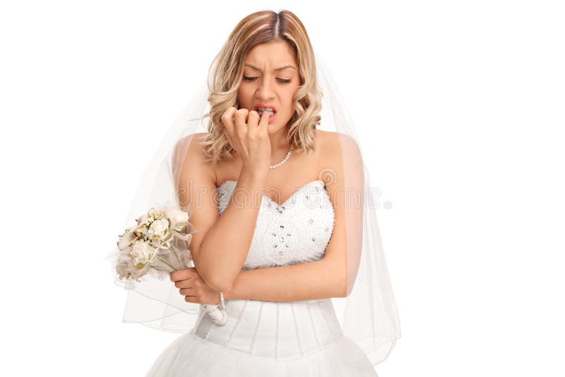 Jeune mariée nerveuse mordant ses ongles images libres de droits