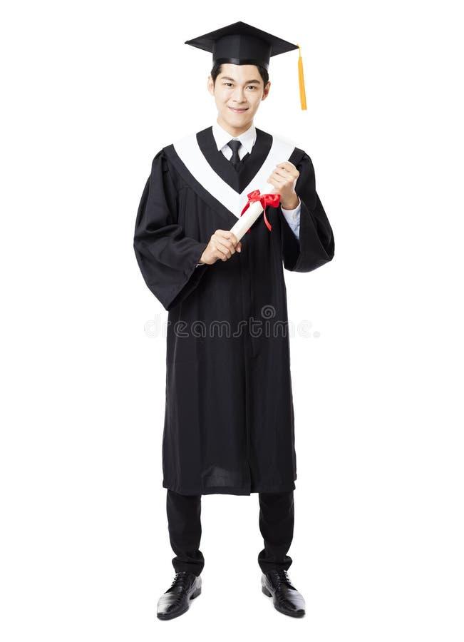 Jeune obtention du diplôme masculine intégrale d'université photos libres de droits