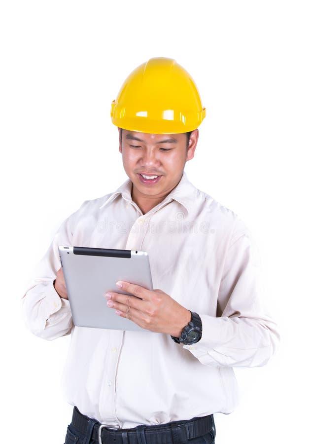 Jeune opération de travailleur de la construction photographie stock libre de droits