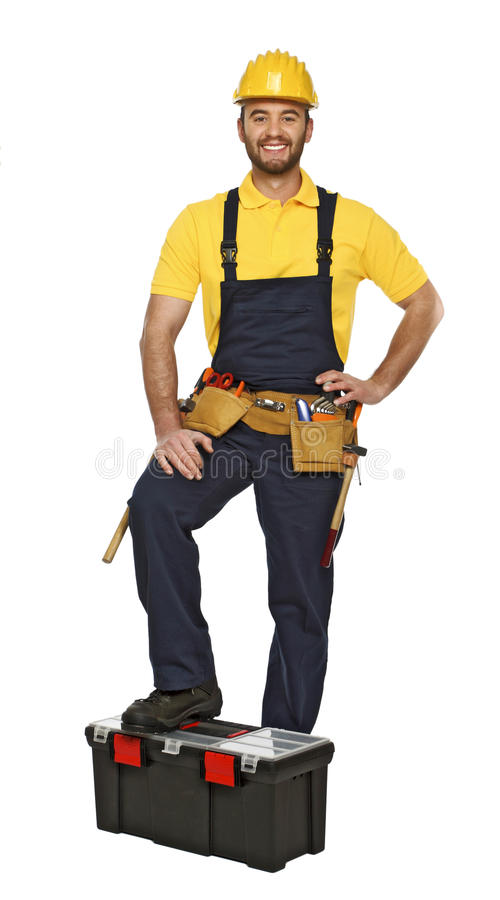 Jeune ouvrier manuel avec la boîte à outils images stock