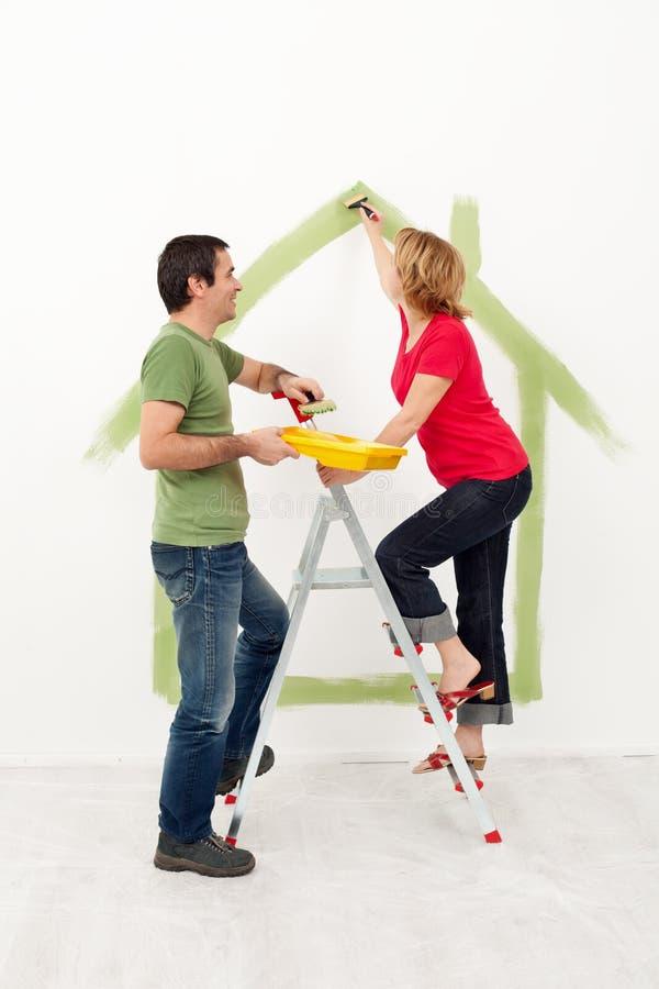 Jeune peinture de couples photos stock