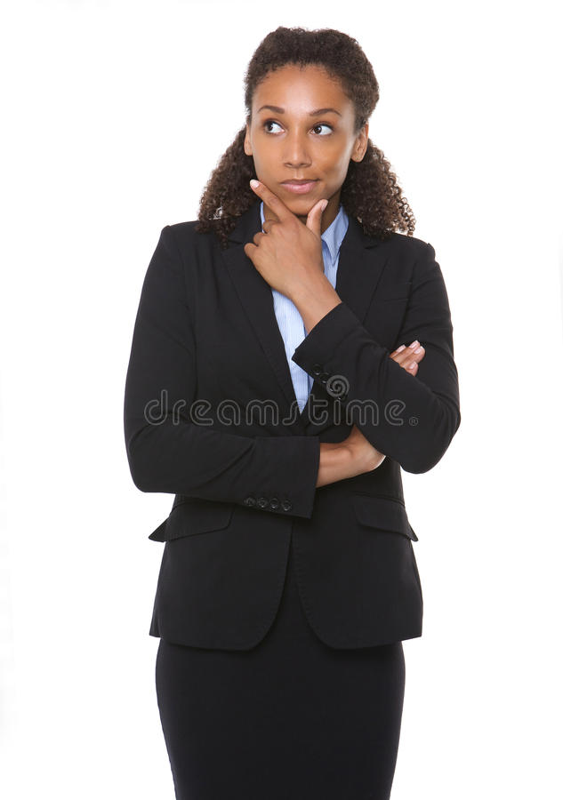 Jeune pensée de femme d'affaires photographie stock libre de droits