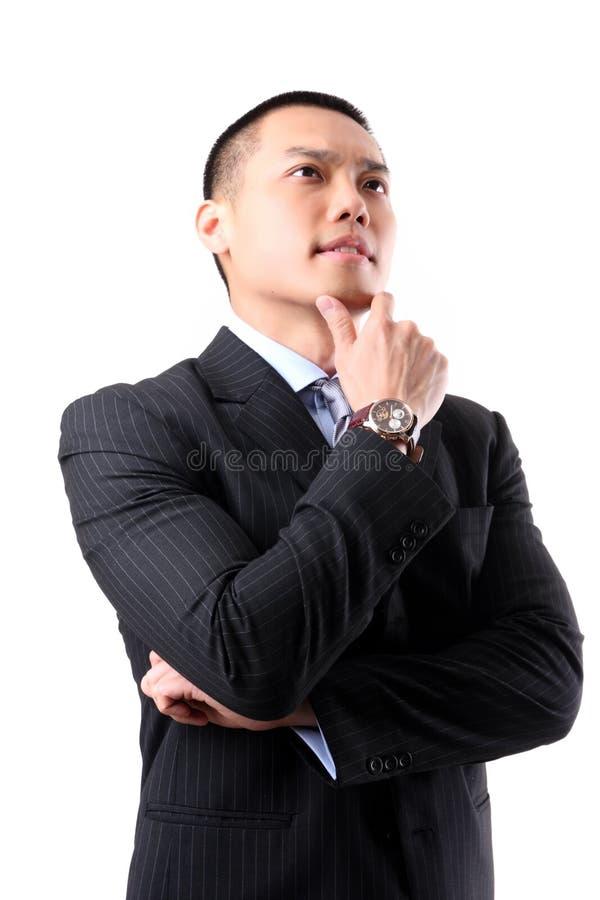 Jeune penser asiatique beau d'homme d'affaires image stock