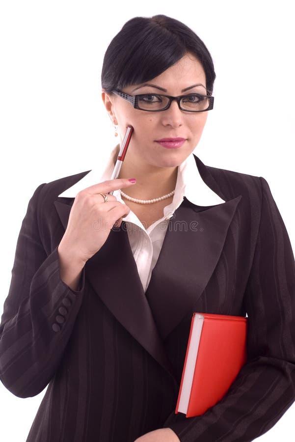 Jeune penser de femme d'affaires image stock