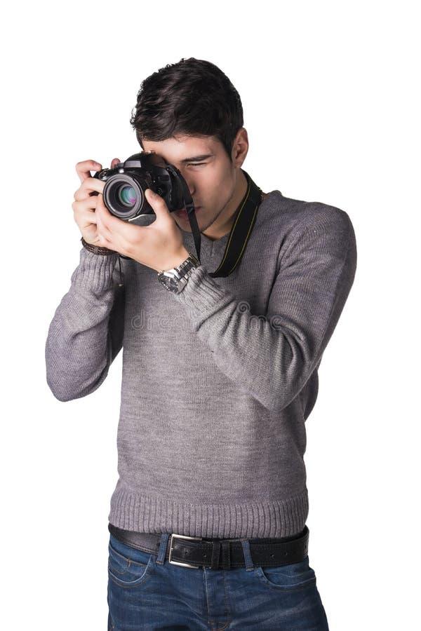 Jeune photographe masculin beau prenant la photographie photographie stock libre de droits
