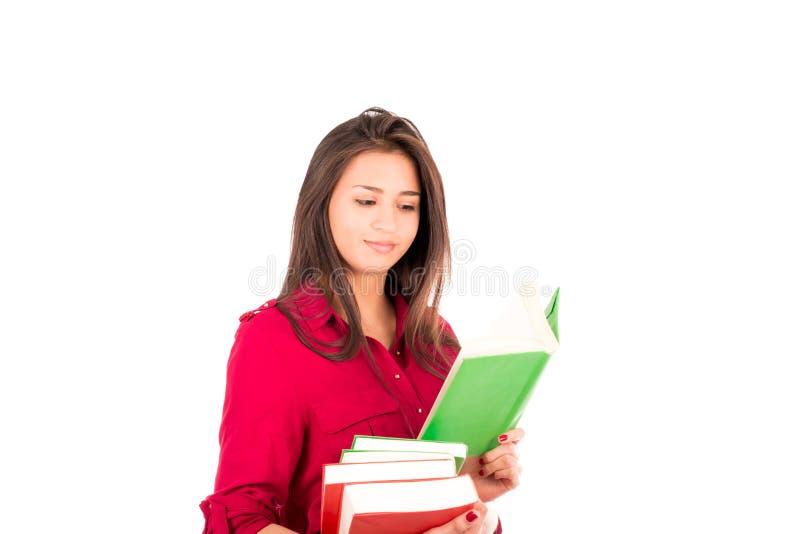 Jeune pile latine de participation de fille de livres et de lecture images stock