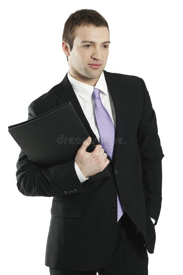 Jeune portefeuille confiant de fixation d'homme d'affaires image stock