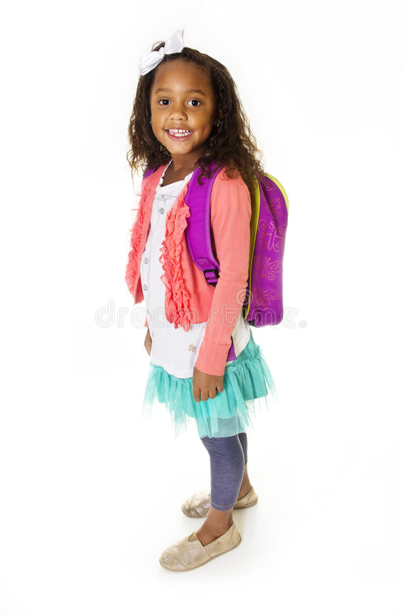 Jeune portrait de fille d'école d'isolement photographie stock libre de droits