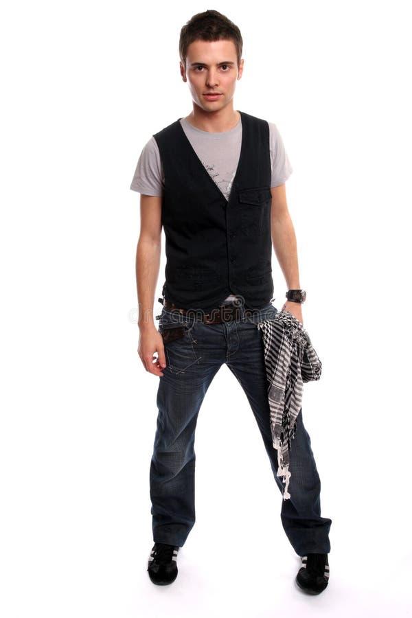 Jeune pose occasionnelle d'homme photographie stock