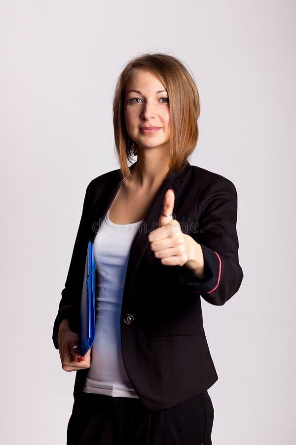 Jeune pouce de femme d'affaires sur le blanc image stock