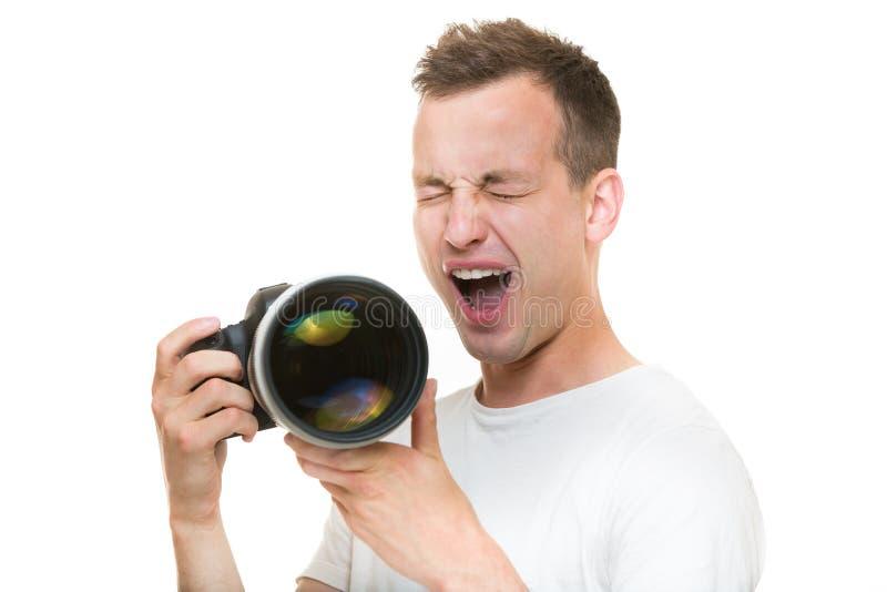 Jeune pro photographe avec l'appareil photo numérique photographie stock