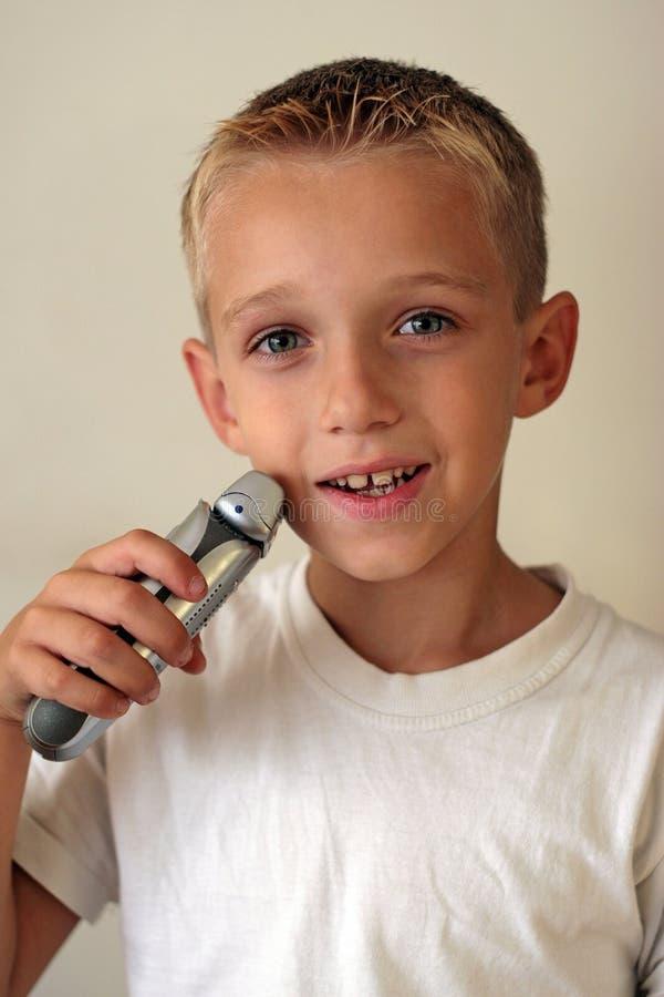 Jeune raser de garçon images stock