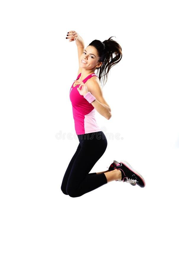 Jeune sauter sportif heureux de femme image libre de droits