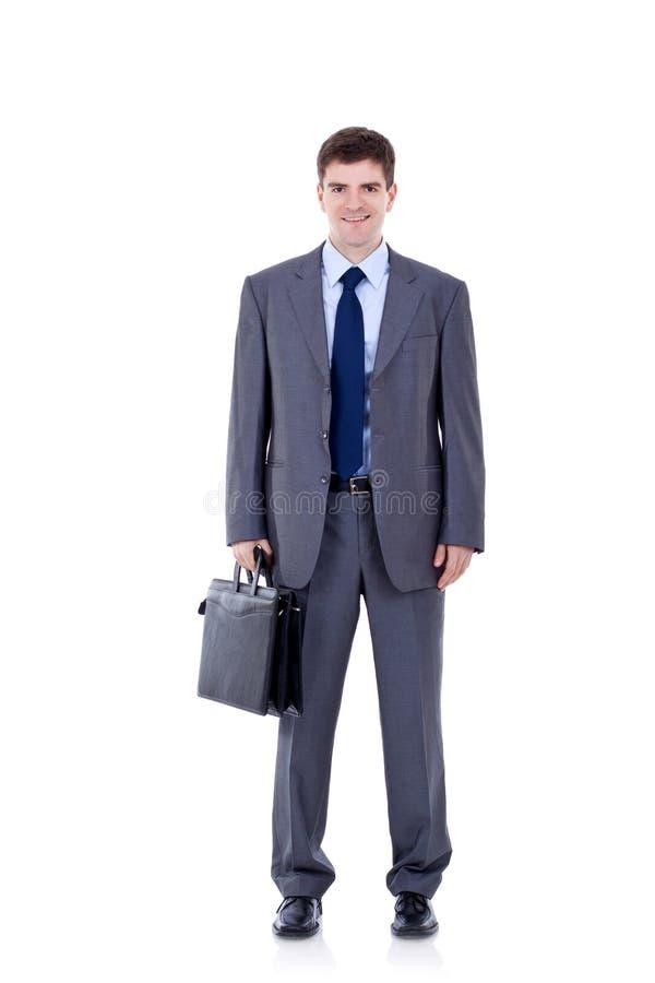 Jeune serviette de fixation d'homme d'affaires photo libre de droits