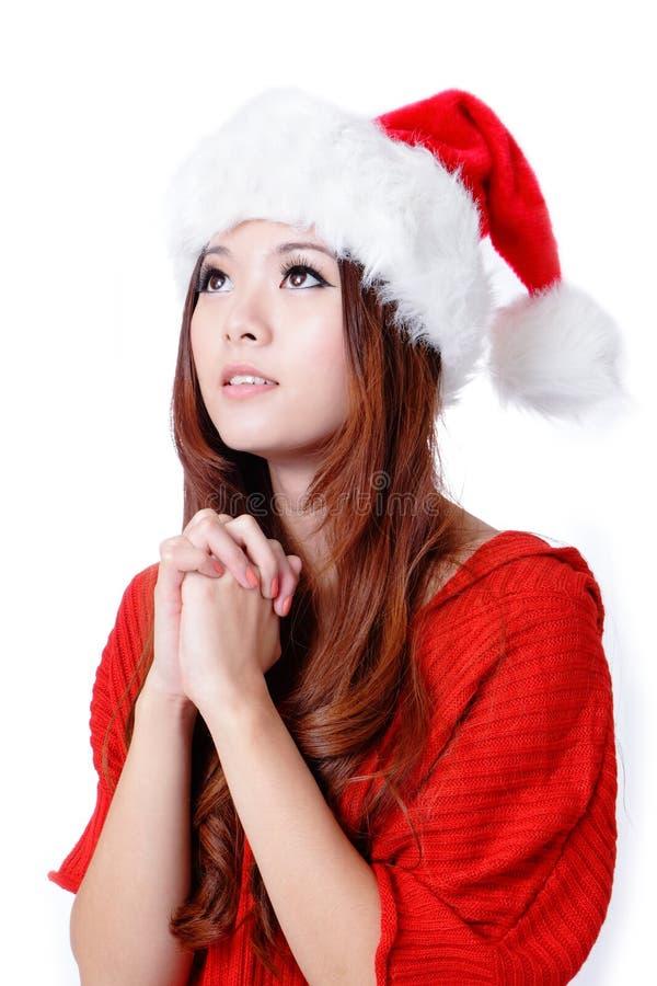 Jeune souhait de fille de beauté avec le chapeau de Noël photo stock