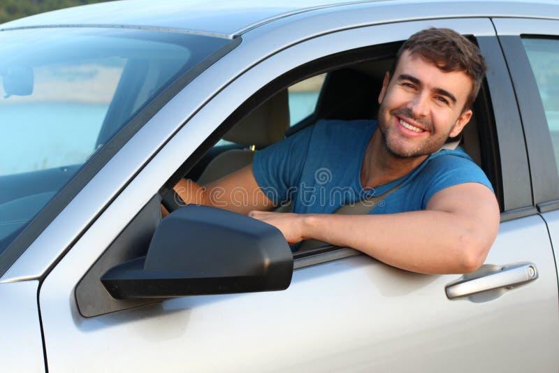 Jeune sourire masculin mignon de conducteur photographie stock