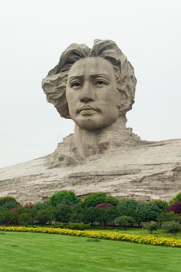 Jeune statue de Mao Zedong d'île orange image libre de droits