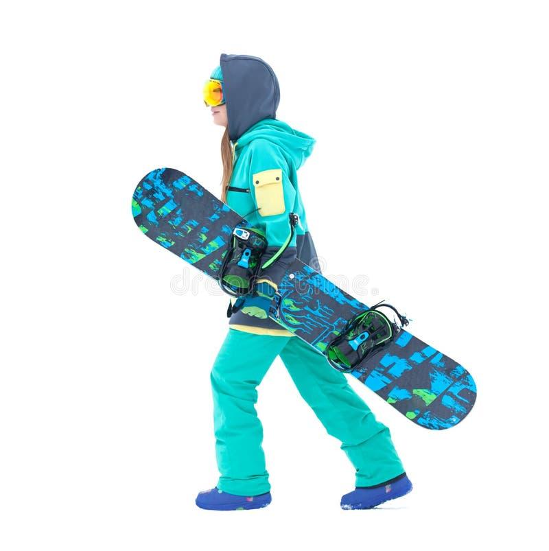 Jeune surf des neiges de participation de fille de surfeur d'isolement photographie stock