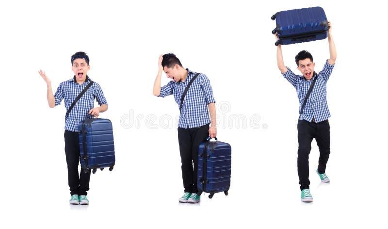 Jeune type avec le cas de voyage sur le blanc image stock