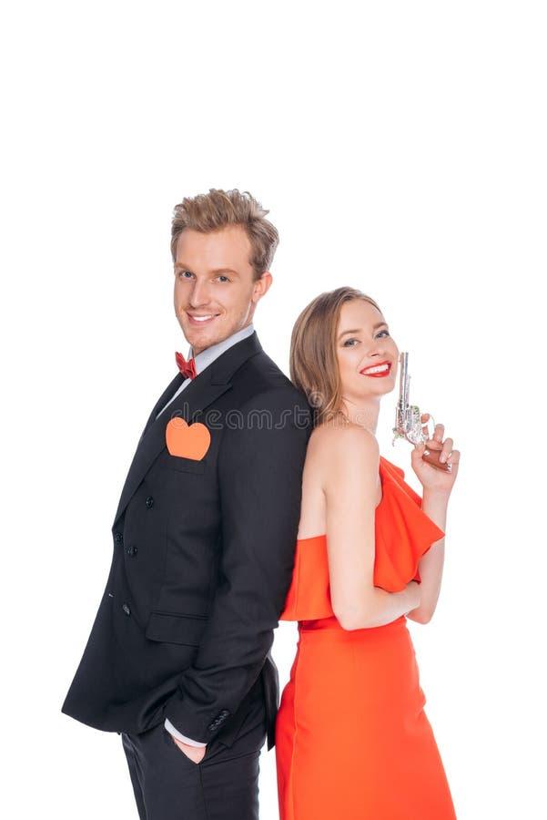 Jeunes ajouter au revolver images stock