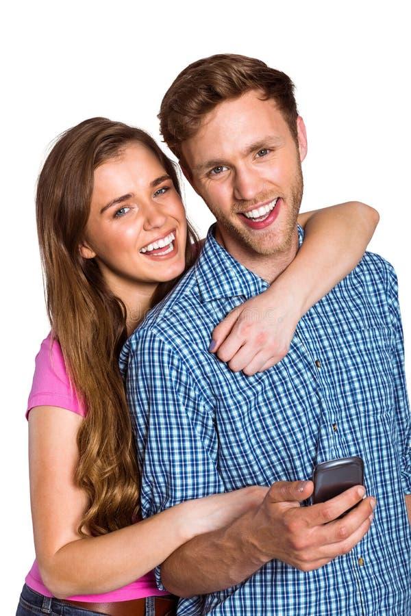 Jeunes ajouter gais au téléphone portable images libres de droits
