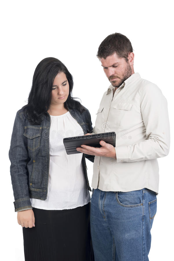 Jeunes ajouter ou enfants de mêmes parents sourds ou malentendants au comprimé photos stock