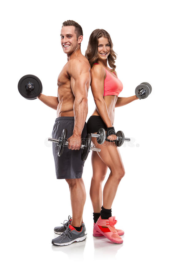 Jeunes ajouter sportifs de belle forme physique à l'haltère photographie stock libre de droits