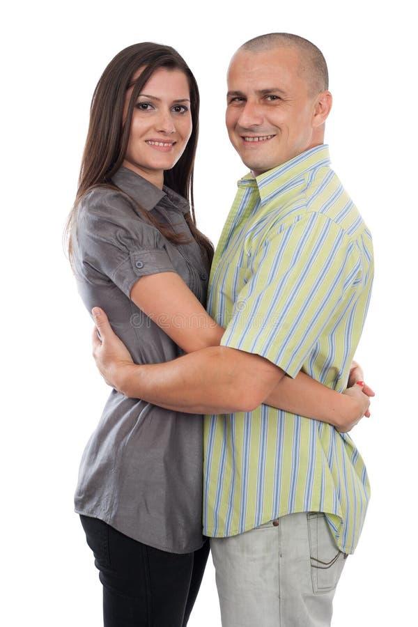 Jeunes couples attrayants d'isolement sur le blanc images stock