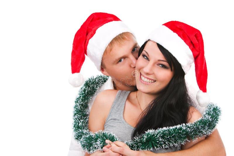 Jeunes couples célébrant Noël photographie stock