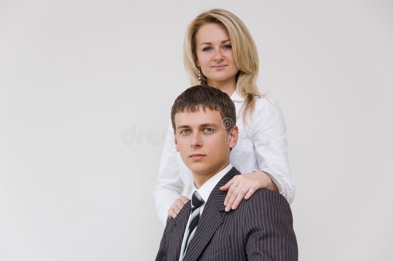 Jeunes couples d'affaires photo stock