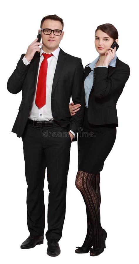 Jeunes couples d'affaires aux téléphones photos libres de droits