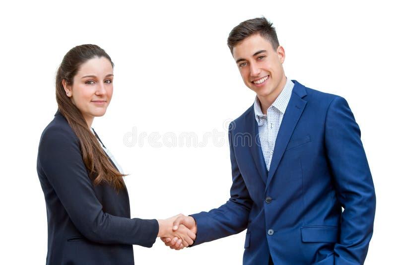 Jeunes couples d'affaires se serrant la main d'isolement photos libres de droits